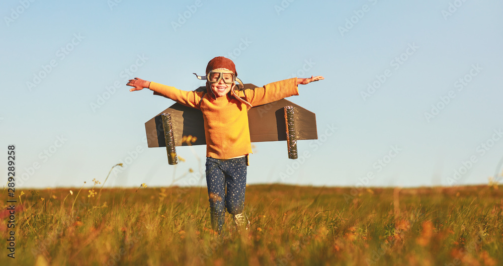 Fototapety, obrazy: Child pilot aviator with wings of airplane dreams of traveling in summer  at sunset