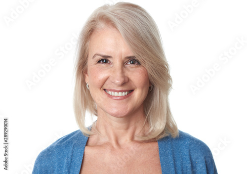 Portrait of beautiful senior woman in front of white background - 289290014