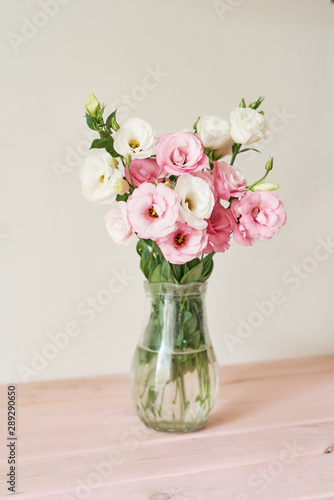a bouquet of eustomas flowers on the table Canvas Print