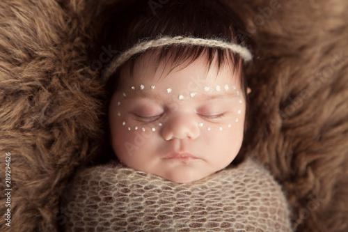 Newborn baby aboriginal girl, traditional facepaint. Wallpaper Mural