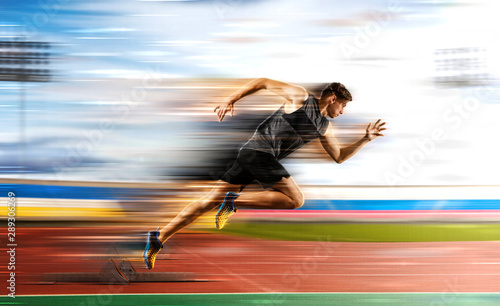 Fototapeta Man running on the athletic track obraz