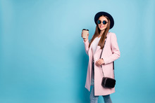 Portrait Of Funny Lovely Lady In Eyeglasses Eyewear Have Rest Stroll With Her Friends Holding Mug Cappuccino Wear Season Coat Denim Jeans Isolated Over Blue Background