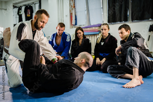 Brazilian Jiu jitsu bjj black belt teaching class or private lessons to his stud Wallpaper Mural
