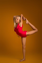 Young Gymnast Child Girl Stretching And Training