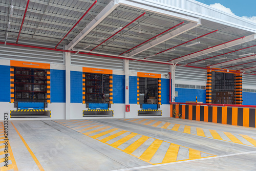 Stampa su Tela Gates entrance ramps of distribution warehouse with docking station for trucks loading goods