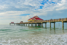 Clearwater Beach, Florida. Partial View Of Pier 60 On Cloudy Sky Background.
