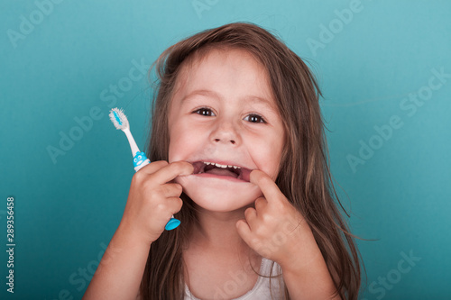 Fotografie, Obraz  Cute little girl brushing her teeth