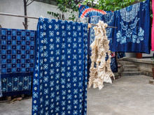 A Small Fabric Which Is Dying Clothes In A Traditional, Handmade Way. The Clothes Are First Stitch Together And Then Dyed. The Fabric Is In Zhoucheng Near The City Of Dali In Yunnan Province (China).
