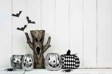 Rustic Halloween Display With Jack O Lantern Decor And Spooky Tree Against A White Wood Background With Copy Space