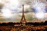 Fototapeta Fototapety z wieżą Eiffla - celebrating the New Year in Paris Eiffel tower with fireworks