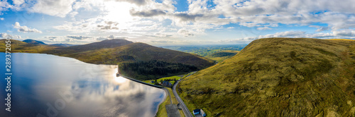 Photographie aerial panoramic view of sunset reservoir in mourne mountain area ,Northern Irel