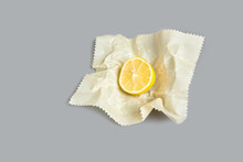 Sliced Lemon Half In Cloth Beeswax Food Storage Wrap / Ecological Alternative To Plastic Cling Wrap
