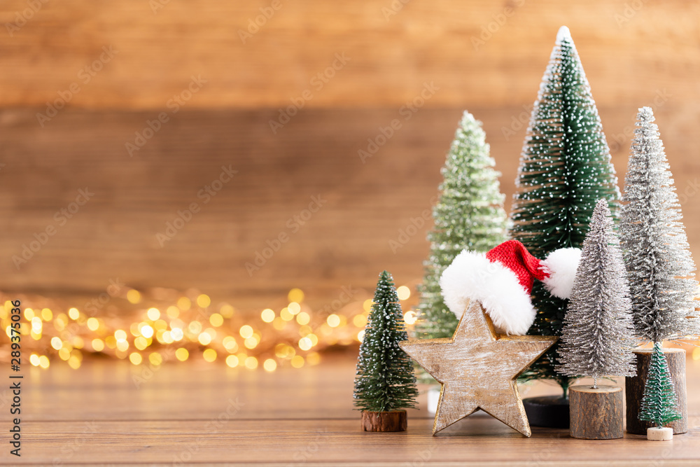 Fototapety, obrazy: Colorful Christmas tree on wooden, bokeh background.