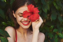 Cheerful Woman Exotic Flowers
