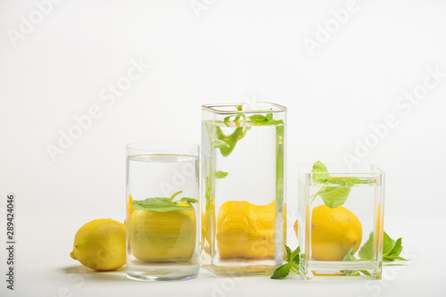 Fotografie, Obraz Foods distorted through liquid and glass on white background.