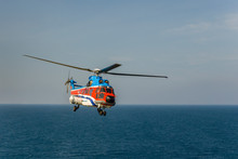 Helicopter Flying Over The Sea