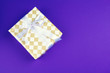 canvas print picture - Gift box on purple background top view