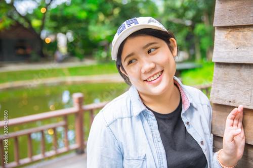 shy portrait cute young innocent Asian teen happy smiling enjoy travel Fototapet