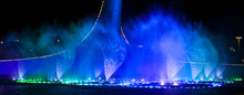 A Dancing Fountain Of Blue In The Park