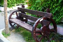 Wooden Park Bench In Garden