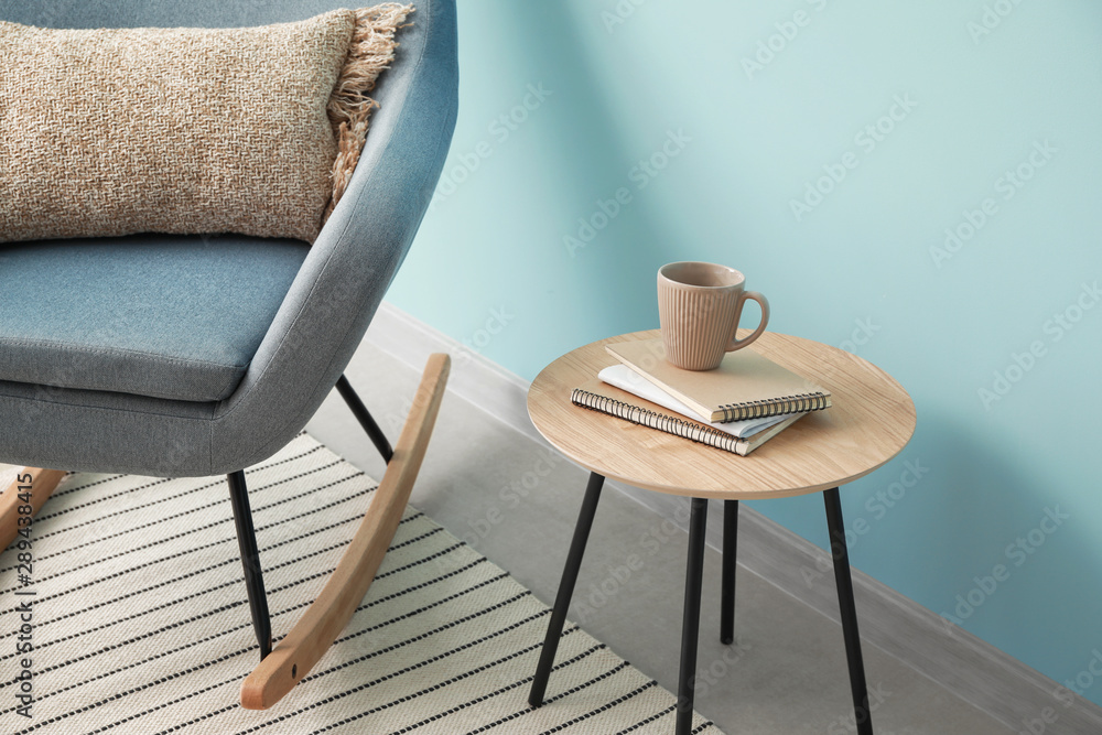 Fototapety, obrazy: Armchair and table near color wall