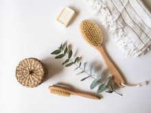 Body Brush With Wooden Handle, Pumice, Wicker Box, White Towel And A Piece Of Soap On A White Background. Top View.