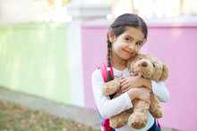 Adorable Little Child Girl With A Teddy Bear Outdoors. School Time.