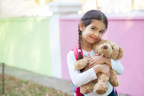 Adorable little child girl with a teddy bear outdoors Canvas-taulu