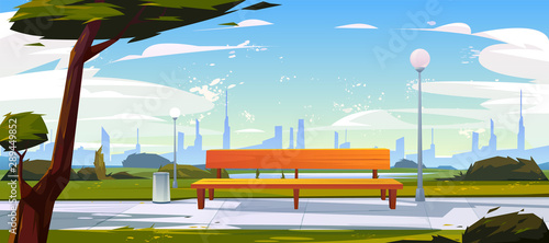Bench in park, summer time landscape with city view background, empty public place for walking and recreation with green trees, litter bins and street lamps Wallpaper Mural
