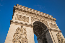 Low Angle Shot The Arc De Triomphe, Paris France, At The Center Of Place Charles De Gaulle, Formerly Named Place De L'Etoile
