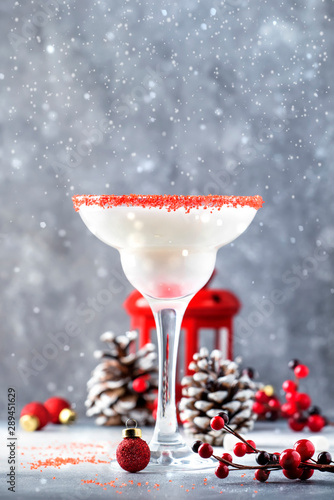 Tuinposter Europa Snow daiquiri, Christmas or New Year alcoholic cocktail with rum and cream with red decor in festive setting, copy space