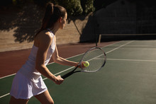 Woman Playing Tennis On A Sunny Day