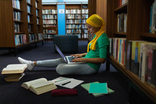 Young Woman Studying In Library