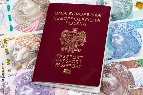 Fototapeta  Polish passport on a background of banknotes