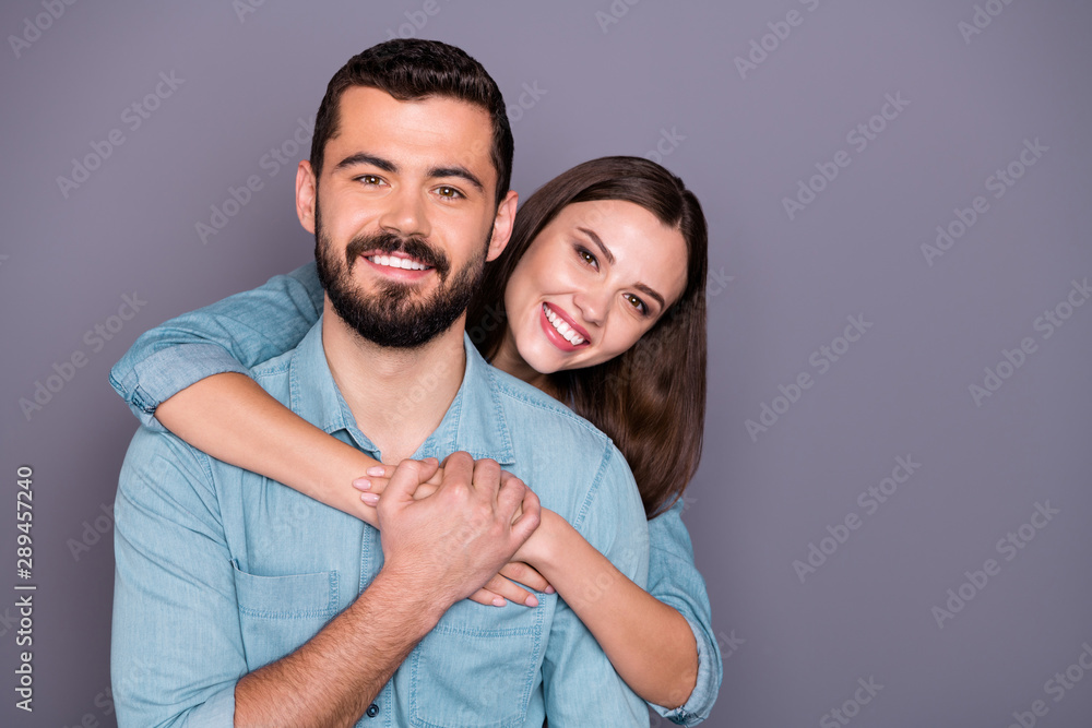 Fototapeta Close-up portrait of two her she his he nice attractive charming lovely cute cheerful cheery person wearing denim jacket embracing isolated over gray violet purple pastel background