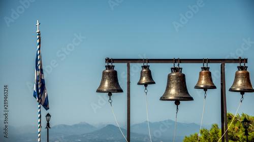 In de dag Schip bells on observation platform at Agios Patapios ( Moni Osiou Patapiou) monastery near Loutraki