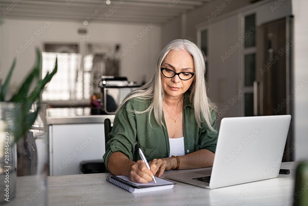 Fototapeta Senior fashionable woman working at home