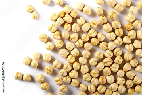 Valokuvatapetti Chickpeas isolated on white background, top view