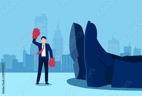 Vector of a small businessman with boxing gloves standing near a giant rival fallen down Wallpaper Mural