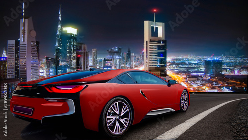 3d illustration. Sports car on our highway, against the backdrop of the night city. - 289487038