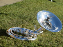 A Polished Tuba At Rest Before...