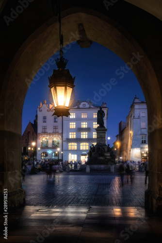 Cracow by night - the cloth hall and the Adam Mickiewicz monument, in Poland, Europe (Krakow , Kraków)