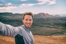 Selfie Tourist Man Hiking In Volcano Mountain Landscape Black Volcanic Rocks. Happy Smiling Youn Adventure Hiker In Summer Travel Destination.