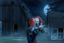 Eerie Clown With A Balloon In ...