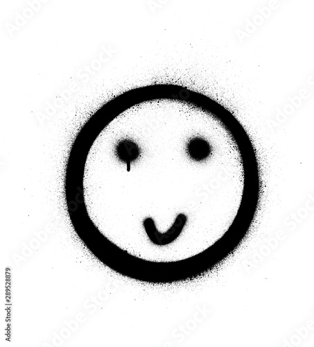 Photo  graffiti shy smiling icon sprayed in black over white