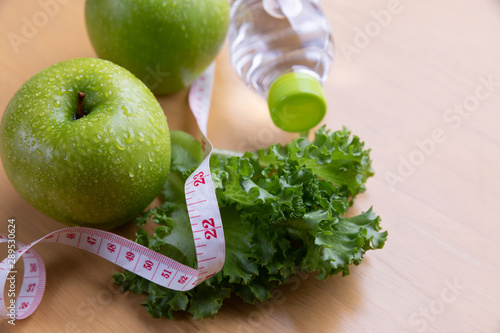 Valokuva  tape measure and water and diet food, weight loss and detox concept
