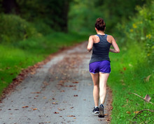 Female Runner On The Towpath Trail