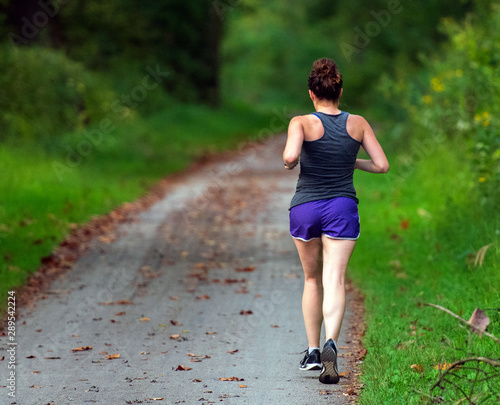 Fotografía Female Runner on the Towpath Trail