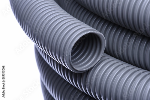 Corrugated pipe for installation of electrical cable isolated on white Fotobehang