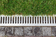 Iron Grate Of A Storm Drainage...